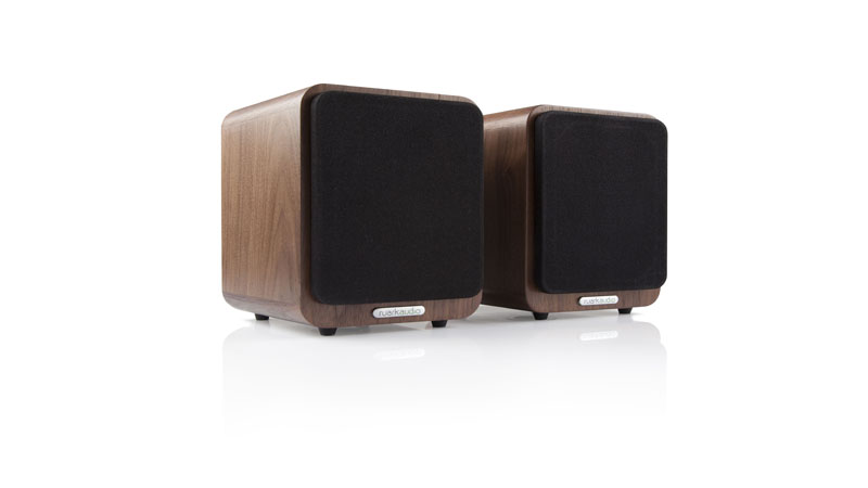 Most smartphones deliver second-rate audio quality but it doesn't have to be, especially when you have the <strong>Ruark Audio MR1</strong>. This Bluetooth speaker system is designed to be used for a variety of music sources, and not just your mobile phone. You can connect the device to TVs and even computers. However, no matter what you play and from what source, the MR1 will make it sound as good as possible. <h2>Better Audio From Your Smartphone With the Ruark Audio MR1</h2> The <strong>Ruark Audio MR1</strong> carries two compact speakers and they each measure at 170-millimeters in height by 130-millimeters in width. All the specifics for the electronics and amplification are housed within the right speaker while the signals are sent to the left with the accompanying coaxial cable. The speakers are housed within hand-crafted wooden cabinets that adds a luxurious feel to them. Most of this wooden material comes from the gorgeous Rich Walnut veneer. Still, if you're not a fan of the wooden finish, know that these speakers are also available in modern-looking black and white finishes as well. There are rounded edges that will appeal to the Apple generation of customers, while still being able to maintain a look to give old-school hi-fi fans something to like about. For the build quality on the <strong>Ruark Audio MR1 Bluetooth Speaker System</strong>, it is unsurprisingly good, if not even excellent. The speaker cabinets feel rigid and weighty. However, they are also placed with high-quality fittings such as sturdy rubber feet underneath and a rear panel that is made completely out of metal. There is a Bluetooth with apt-x connectivity feature which means that users are able to play CD-quality audio from compatible devices. Each speaker has a long-throw 75-millimeter subwoofer with a neodymium magnet system. While this does sound, look, and feel like a premium device, the price kind of reflects that notion as well as it costs more than traditional ferrite systems. 