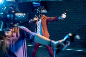 An image featuring a person using an Oculus and is playing some VR game