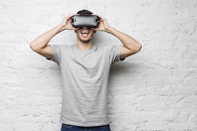 An image featuring an excited person using VR Oculus concept