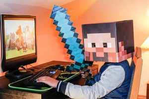 An image featuring a person with a Minecraft head and sword playing Minecraft concept